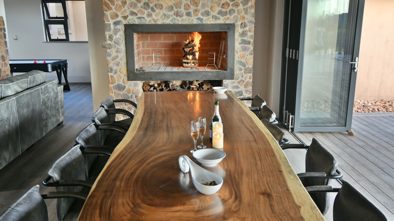 Dining room and fireplace at Gweda Lodge luxury accommodation in Mabalingwe Bela-Bela